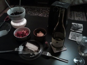 chocolate fondue with strawberries and the last (I swear) of grandma's cheese curds, Lunds Bailey's cheesecake, and Hawley wine